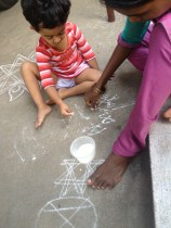 The kolam powder eventually became a tool to try her ABCs :)