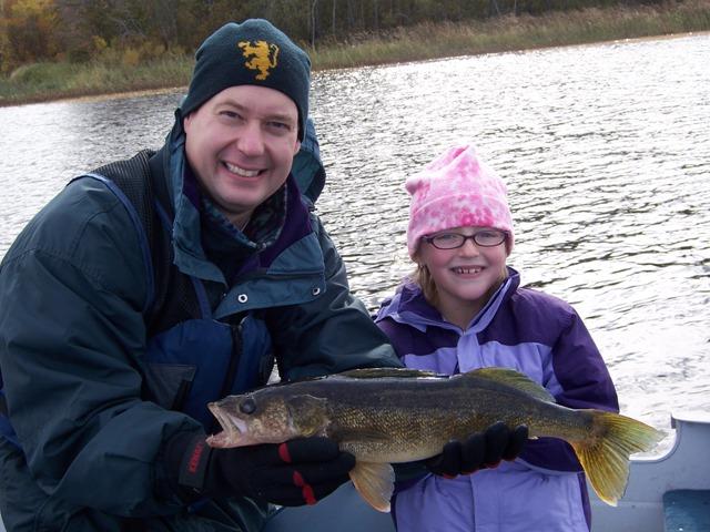 Jon and Rachel with her 21.5 walleye