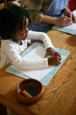 African-American Waldorf Nursery student coloring. Admissions.
