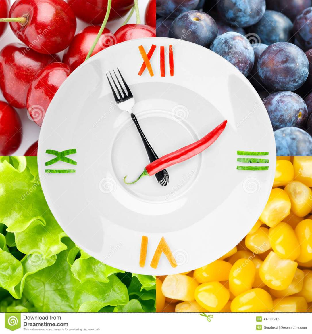 healthy-food-concept-clock-vegetables-fruits-as-background-44181215