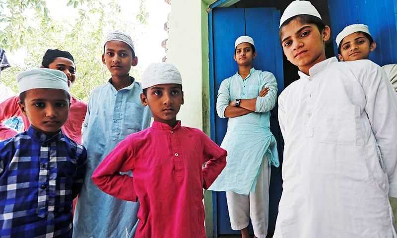 Photo of In Indian village, Muslims talk of leaving as divide with Hindus widens