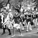 Miss Alabama Carol Self and drum major Bill Fuqua march at the head of the band for the 1964 homecoming parade.