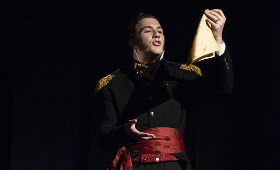 Iago holds the handkerchief with which he will frame Desdemona and Cassio