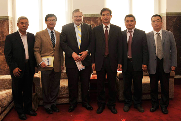 Robert Olin and Luoheng Han with representatives of