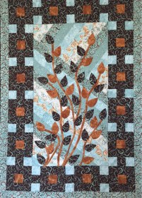 Blue quilt with colored blocks and vines