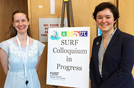 Alison Farrar in front of a poster that says SURF Colloquium in Progress