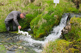 Jon Benstead tests a stream of water in Iceland