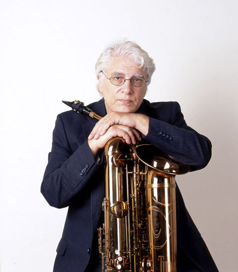 Vinny Golia, leaning against a saxophone