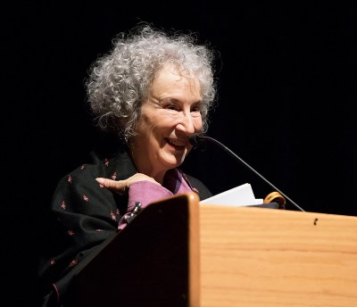 Margaret Atwood standing at a podium, smiling