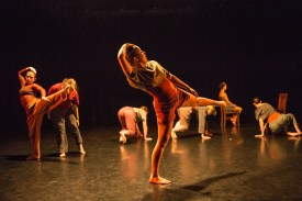 seven students dance on stage