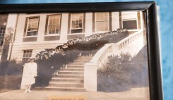 Photograph taken of 1928 women graduates in front of Carmichael Hall.