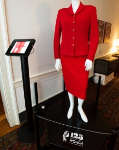 Two-piece red knit suit worn by Judith Bonner, first woman to be named president of Alabama's flagship university.