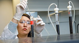 researcher conducting an experiment