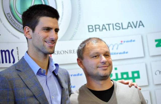 Serbian tennis player Novak Djokovic posing with his coach Marian Vajda during a press conference in Bratislava.
