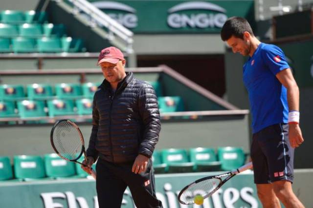 Novak Djokovic of Serbia and his coach Marian Vajda during a training session prior the 2015 French Open tennis championships