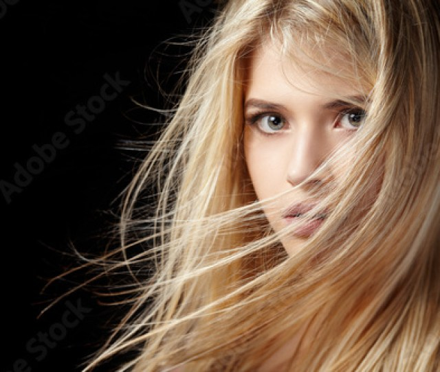 Portrait Of Beautiful Blonde Woman With Flying Hair