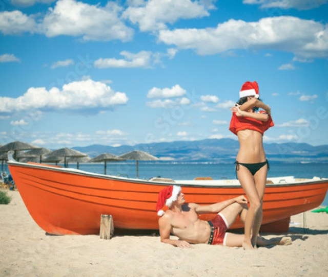 Christmas Couple Wearing Santas Hats Smiling Family Celebrating New Year At Home Romantic Concept