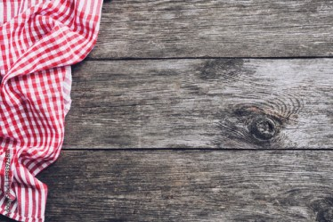 Kitchen plaid textile on old rustic wood Food menu background Buy this stock photo and explore similar images at Adobe Stock Adobe Stock