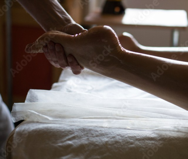 Professional Masseur Doing Kneads Legs Of A Girl At Ayurveda Oiled Massage Session