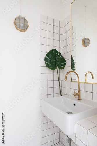 https stock adobe com images cozy wash basin corner with white tile and gray grout on the background rectangle gold mirror and diy wall lamp cozy interior concept 202227828 start checkout 1 content id 202227828
