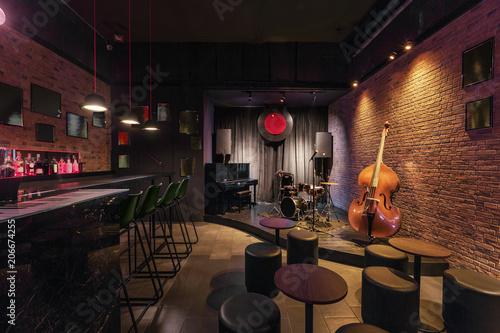 Modern jazz bar interior design stage with black piano