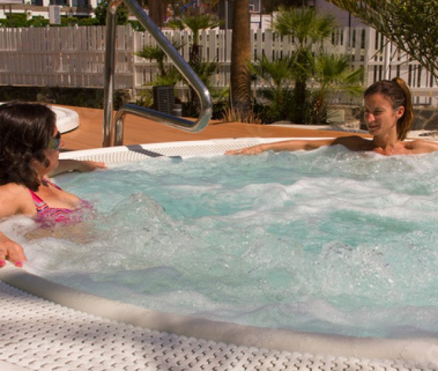 Young Women Chilling Out On Jacuzzi In Summer Time Girl Friends Chat While Resting In