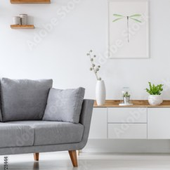 Living Room Clocks Next Decorating Ideas 2018 Real Photo Of A Grey Couch Standing To Shelf With Vases In White