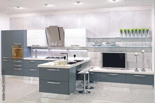 Cucina moderna con parete attrezzata  Buy this stock photo and explore similar images at Adobe