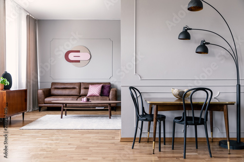 living room clocks next michael amini sets real photo of metal lamp standing to dining table with two black chairs in open