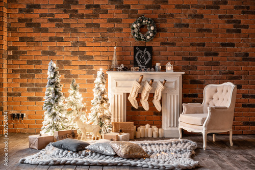 Loft Apartments Brick Wall With Candles And Christmas Tree Wreath White Wool Socks For