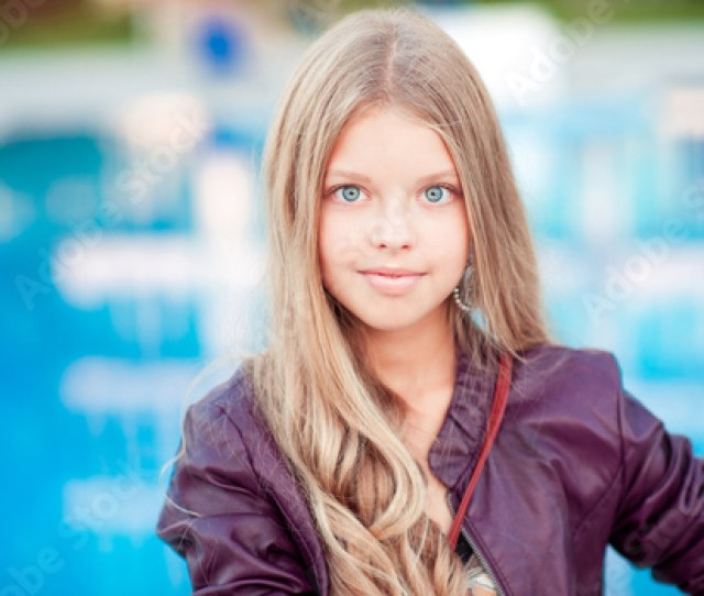 Smiling Blonde Teenager Girl 12 15 Year Old Posing Over Sea Background Outdoors Looking At Camera Beautiful Teens Summer Time Childhood