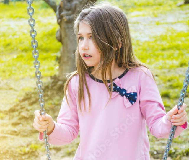Portrait Of A Little Girl Sitting On The Swing Lifestyle People Kid