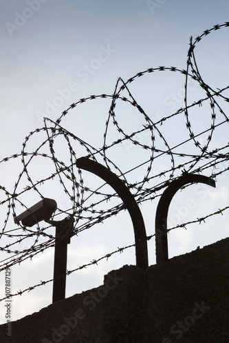 Stretching Barbed Wire Fence