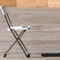 Folding Chair For Less Clear Plastic Dining Chairs The Buy This Stock Photo And Explore Similar Images