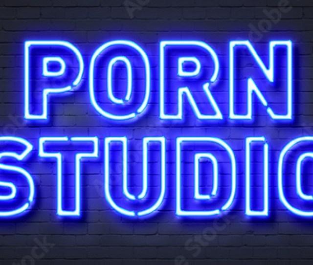 Porn Studio Neon Sign On Brick Wall Background