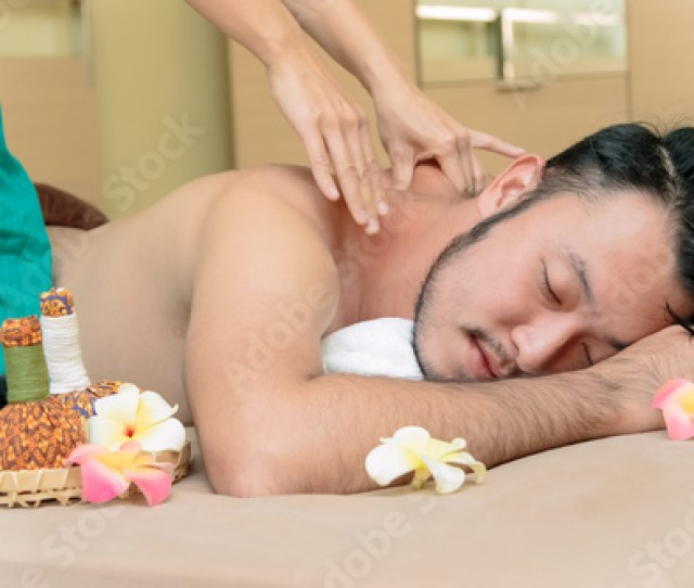 Happy Asian Man Lying On The Massage Table And Smiling Spa Concept