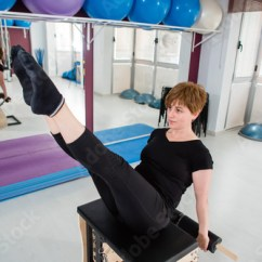 Pilates Chair For Sale Simply Bows And Covers Cumbria Woman Exercising On Combo Wunda Buy This Stock Photo