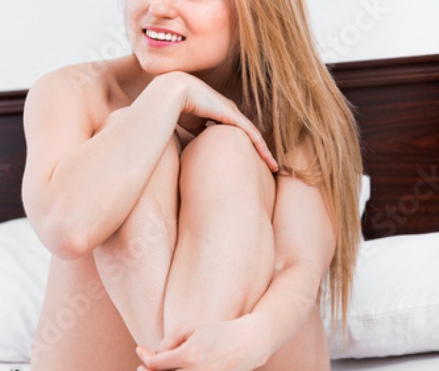 Woman Without Clothes Standing And Covering Herself With A Sheet