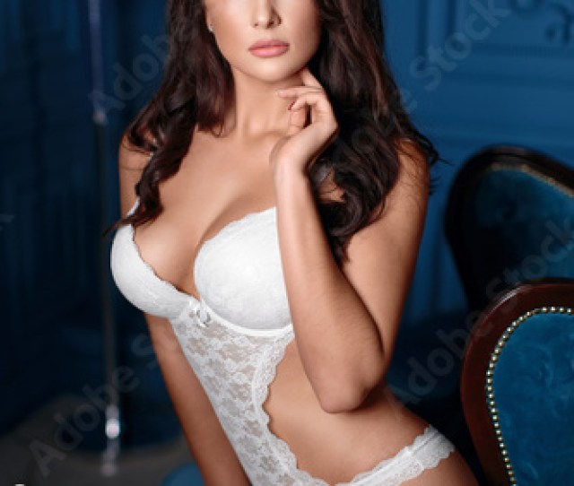 Gorgeous Brunette In White Lingerie In An Expensive Interior