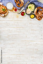 Oktoberfest food menu bavarian sausages with pretzels mashed potato sauerkraut beer bottle and mug white wooden background copy space top view Buy this stock photo and explore similar images at Adobe