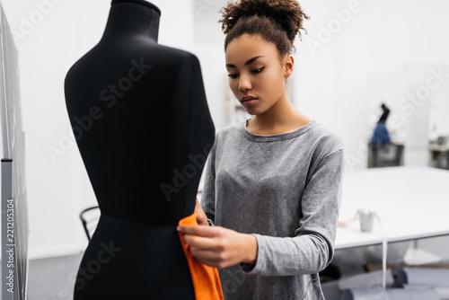 cheerful dark skinned dressmaker