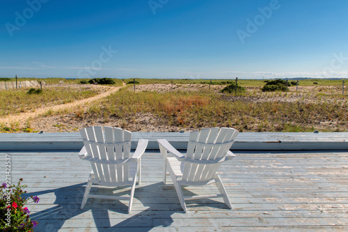cape cod beach chair danish modern at sunset with chairs on massachusetts usa