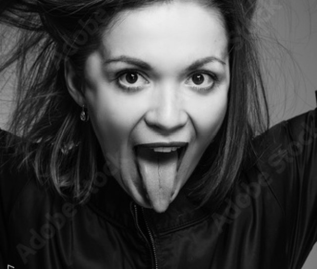 Girl Shows The Tongue With Her Mouth Open And Picks Up Hair Depicts Beast Studio