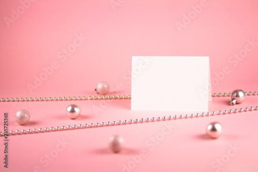 Mock up with vertical invitation card on trendy pastel light pink background with pink christmas balls and pink bead Buy this stock photo and explore similar images at Adobe Stock