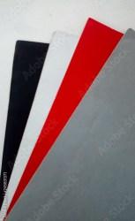 Cartulinas de color negro blanco rojo y gris en fondo blanco Buy this stock photo and explore similar images at Adobe Stock Adobe Stock