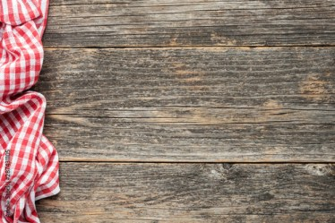 Red checkered picnic textile on rustic wooden planks background Top view copy space Cooking food menu background Buy this stock photo and explore similar images at Adobe Stock Adobe Stock