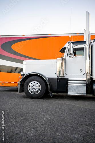 parking lot beside orange semi truck