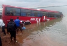 VIP bus trapped in River Oti