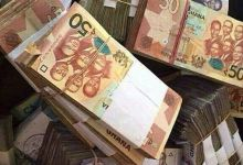 Wads of 50-cedi notes