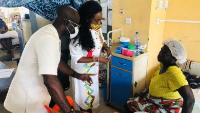 Nana Asante Bediatuo and wife interacting with a patient